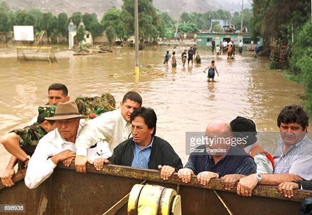 Peruvian President Alejandro Toledo and Health Minister Carlos Bruce inspect damages February 5 2002 caused by recent floods from heavy rains in...
