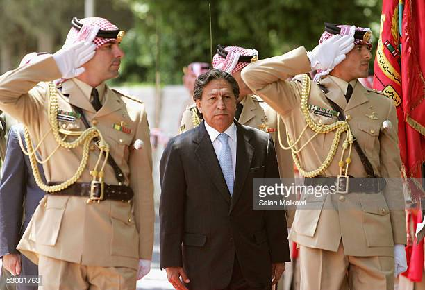 Peruvian President Alejandro Toledo reviews the honour guard as he is received by Jordan's King Abdullah upon his arrival at the Royal Palace in...