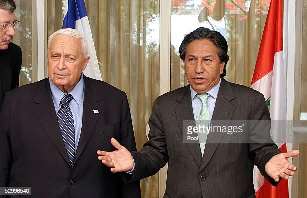 Peruvian president Alejandro Toledo speaks to the media as Israeli Prime Minister Ariel Sharon looks on at Sharon's residence May 29 2005 in...