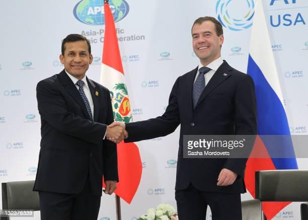 Peruvian President Ollanta Humala greets Russian President Dmitry Medvedev on November 11 2011 in Honolulu Hawaii The US is hosting this year's APEC...