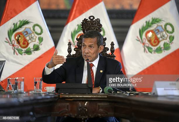 Peruvian President Ollanta Humala speaks during a press conference with the foreign press in his office at the presidential palace in Lima on March 2...