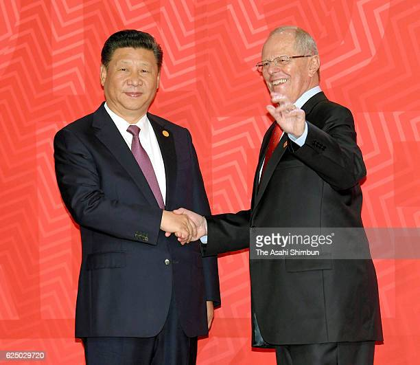 Peruvian President Pedro Pablo Kuczynski welcomes Chinese President Xi Jinping prior to the AsiaPacific Economic Cooperation summit meeting on...