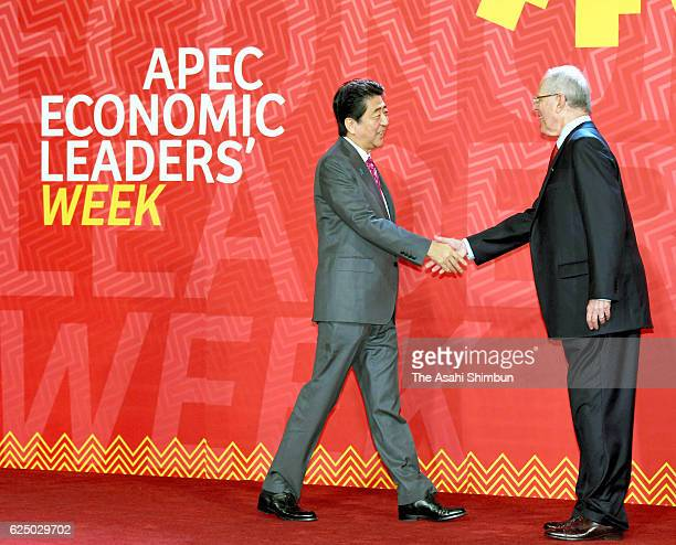 Peruvian President Pedro Pablo Kuczynski welcomes Japanese Prime Minister Shinzo Abe prior to the AsiaPacific Economic Cooperation summit meeting on...
