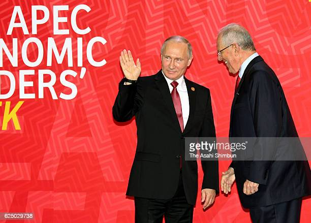 Peruvian President Pedro Pablo Kuczynski welcomes Russian President Vladimir Putin prior to the AsiaPacific Economic Cooperation summit meeting on...