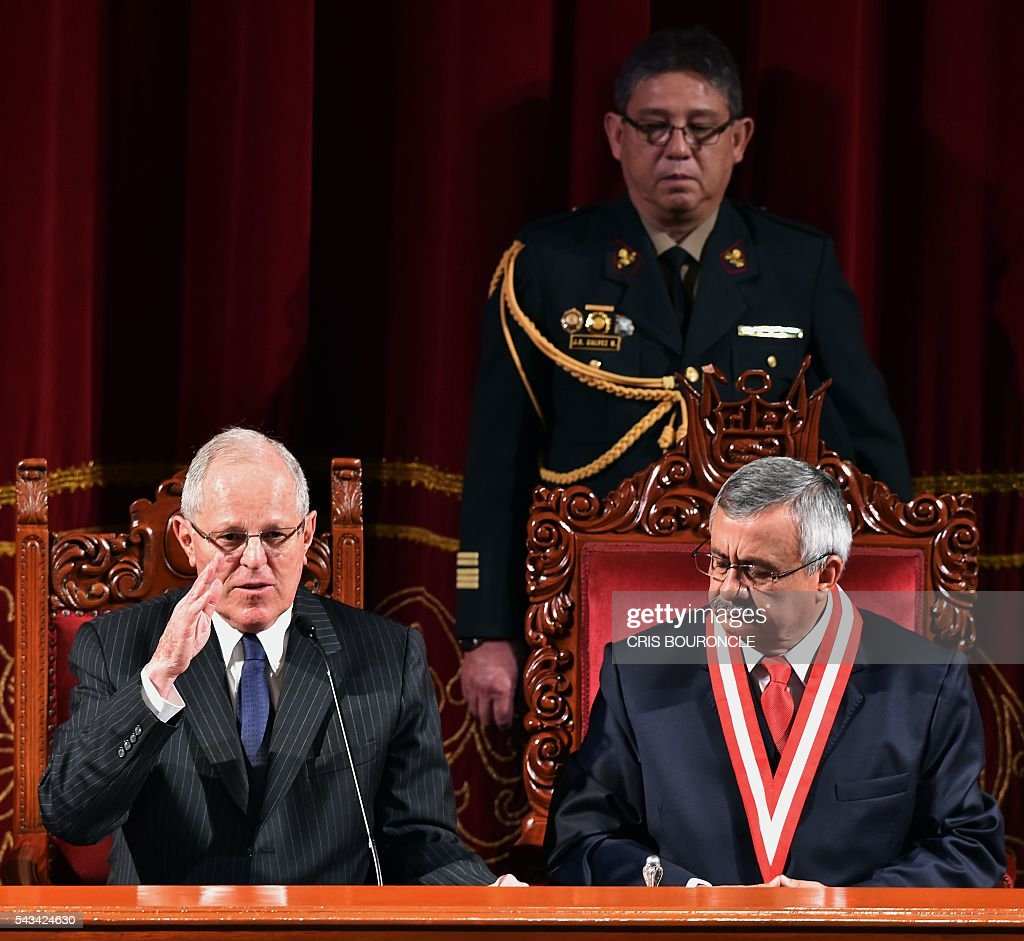 Peruvian President-elect Pedro Pablo Kuczynski (L) delivers a speech after receiving his presidential credentials from the president of the National Electoral Jury (JNE), Francisco Tavara (R), in Lima on June 28, 2016 a month before taking office. Kuczynski will be sworn in as president for a five-year term on July 28. / AFP / CRIS