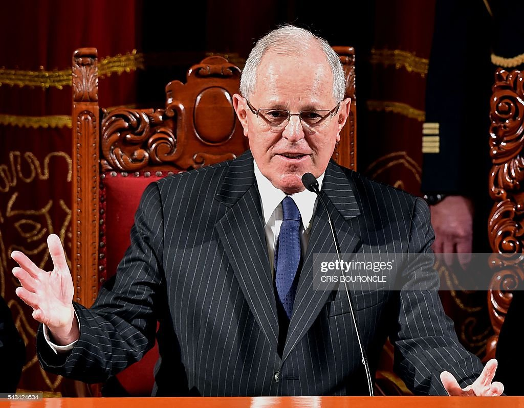 Peruvian President-elect Pedro Pablo Kuczynski (L) delivers a speech after receiving his presidential credentials from the president of the National Electoral Jury (JNE), Francisco Tavara (out of frame), in Lima on June 28, 2016 a month before taking office. Kuczynski will be sworn in as president for a five-year term on July 28. / AFP / CRIS