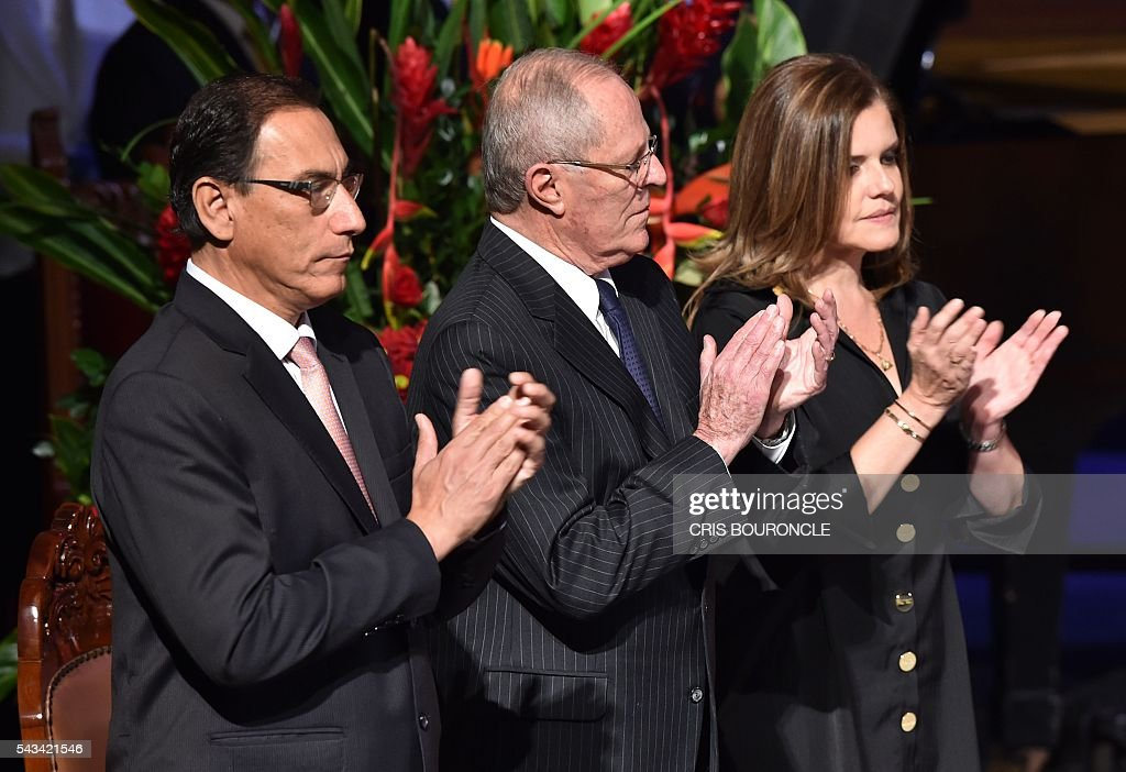 Peruvian President-elect Pedro Pablo Kuczynski (C), his Vice-President Martin Vizcarra (L), and second Vice-President Mercedes Araoz applaud in Lima on June 28, 2016 during the ceremony to receive credentials a month before taking office. Kuczynski will be sworn in as president for a five-year term on July 28. / AFP / CRIS