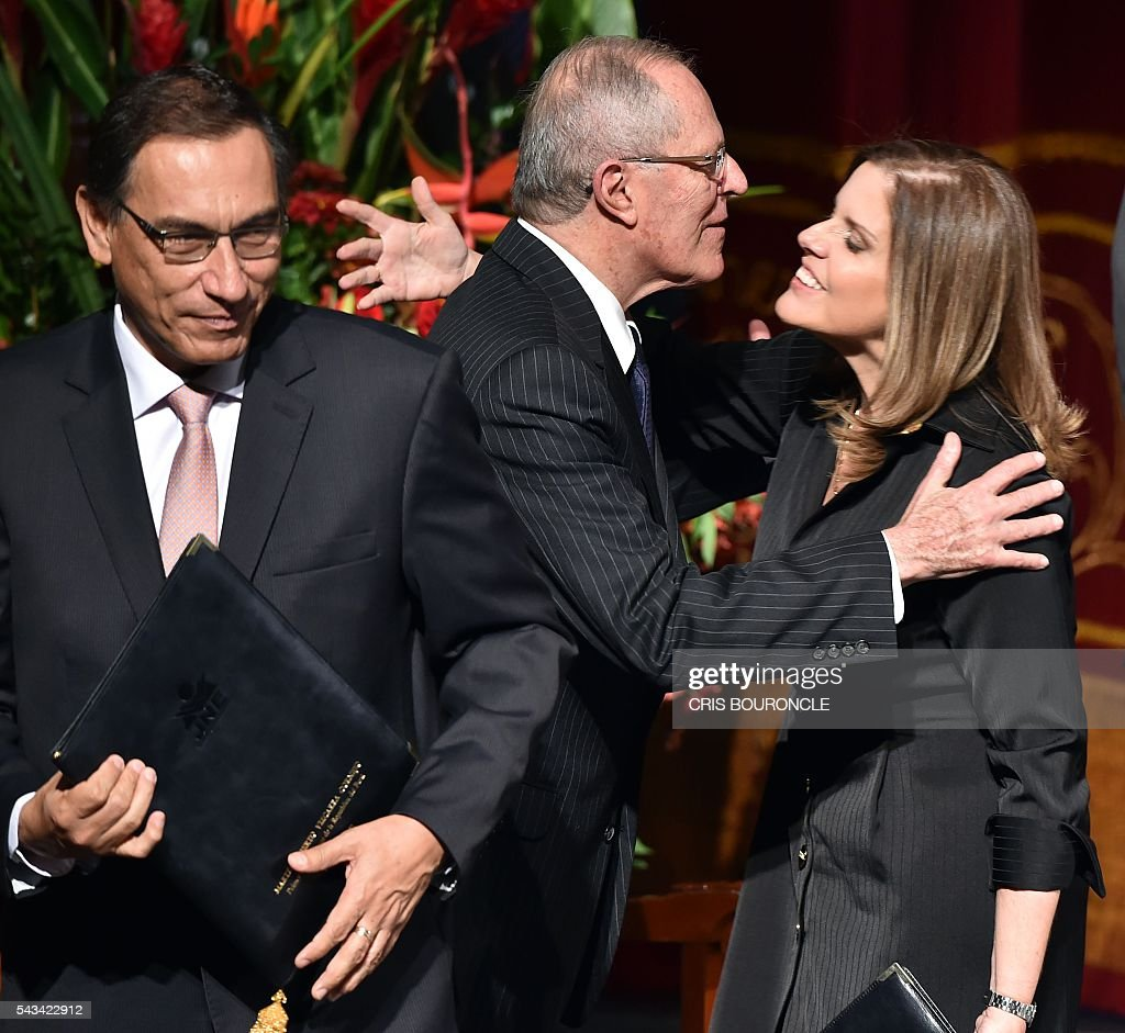 Peruvian President-elect Pedro Pablo Kuczynski (C), his Vice-President Martin Vizcarra (L), and second Vice-President Mercedes Araoz are pictured in Lima on June 28, 2016 during the ceremony to receive credentials a month before taking office. Kuczynski will be sworn in as president for a five-year term on July 28. / AFP / CRIS