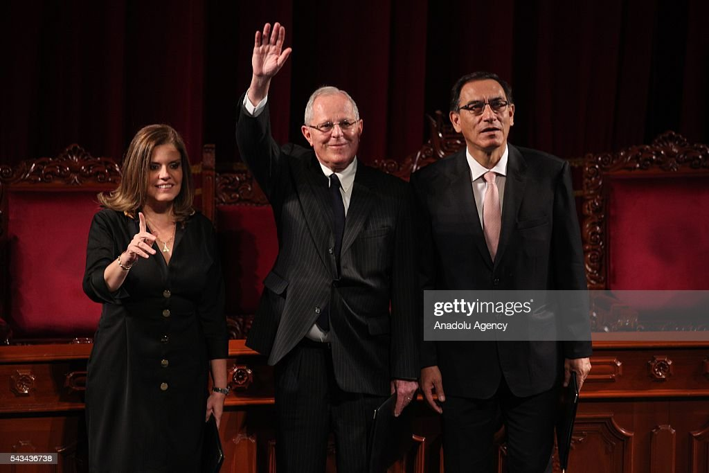 Peruvian President-elect Pedro Pablo Kuczynski (C), his Vice-President Martin Vizcarra (R) and second Vice-President Mercedes Araoz wave after receiving their presidential credentials during a ceremony in Lima on June 28, 2016 a month before taking office.