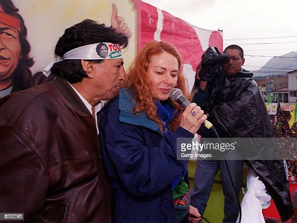 Peruvian presidential candidate Alejandro Toledo speaks to his wife Eliane Karp during a really March 27 2001 in the Andean town of Huaraz Peru...