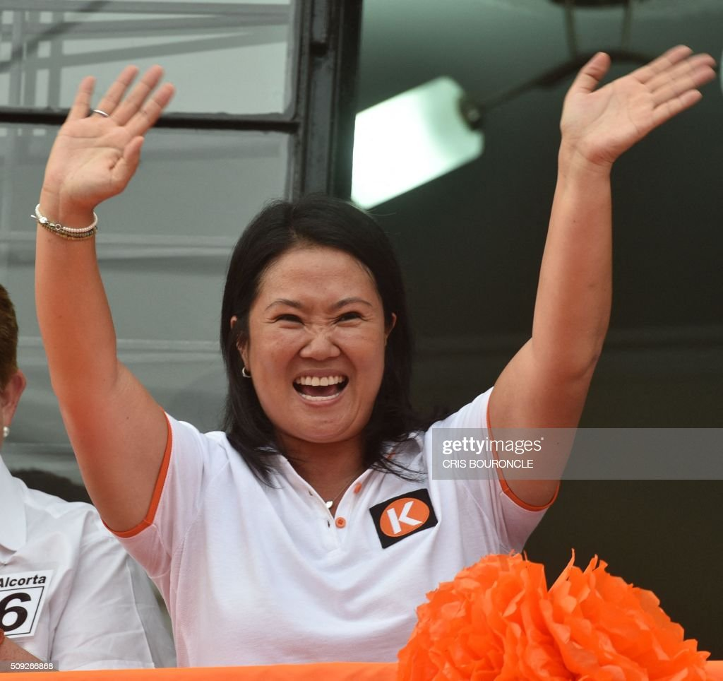 Peruvian presidential candidate for the April 10 general election, Keiko Fujimori leader of the Fuerza Popular Party, waves during a campaign rally in Lima, on February 9, 2016. Fujimori, daughter of imprisoned Peruvian former President Alberto Fujimori, consistently leads the polls. AFP PHOTO/CRIS BOURONCLE / AFP / CRIS BOURONCLE