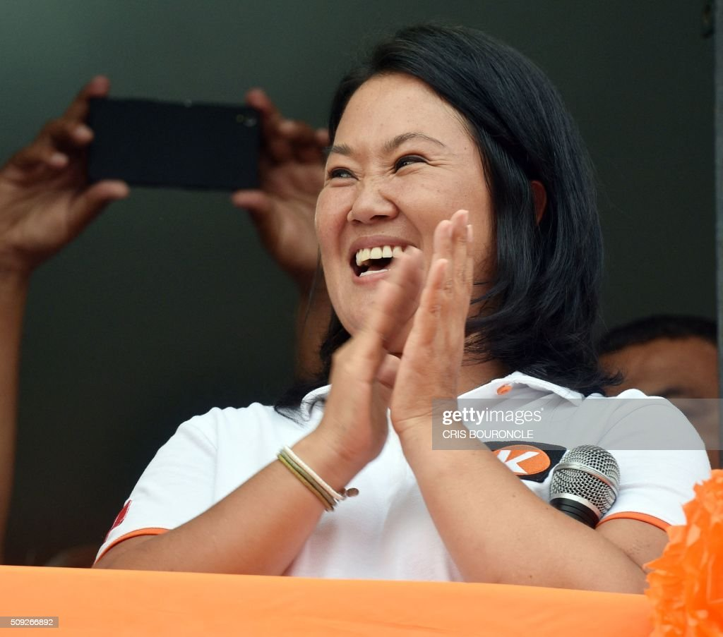 Peruvian presidential candidate for the April 10 general election, Keiko Fujimori leader of the Fuerza Popular Party, applauds during a campaign rally in Lima, on February 9, 2016. Fujimori, daughter of imprisoned Peruvian former President Alberto Fujimori, consistently leads the polls. AFP PHOTO/CRIS BOURONCLE / AFP / CRIS BOURONCLE