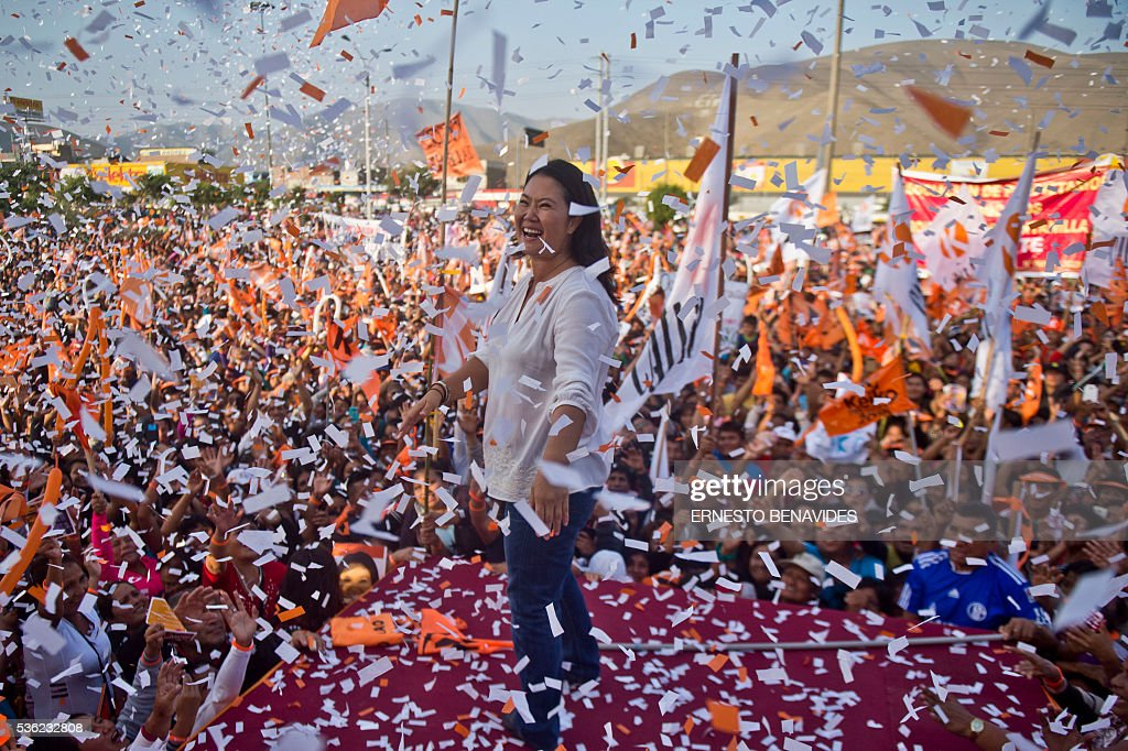 Peruvian presidential candidate for the Fuerza Popular (Popular Force) party and daughter of imprisoned former Peruvian President (1990-2000) Alberto Fujimori, Keiko Fujimori, smiles during a rally in Lima on May 31, 2016. Fujimori leads the polls for next May 5 presidential elections in Peru. / AFP / ERNESTO
