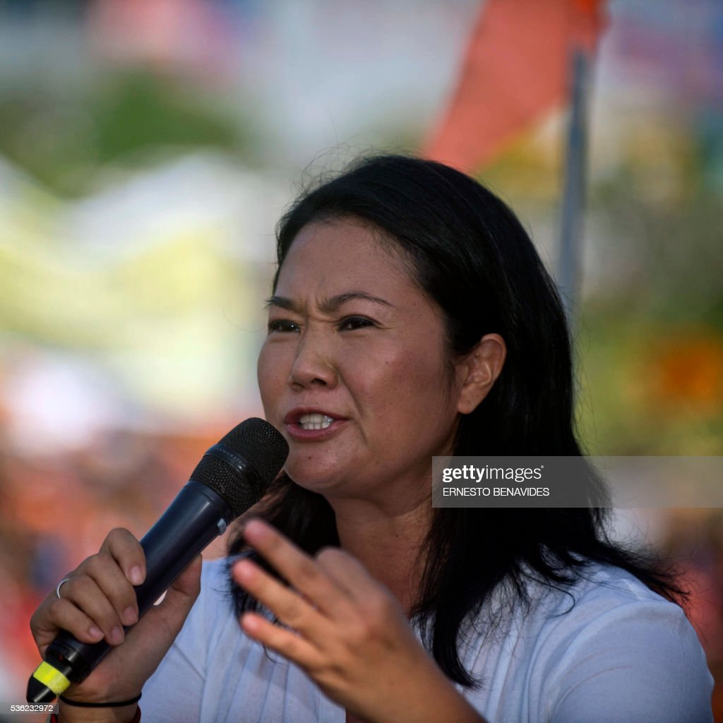 Peruvian presidential candidate for the Fuerza Popular (Popular Force) party and daughter of imprisoned former Peruvian President (1990-2000) Alberto Fujimori, Keiko Fujimori, speaks during a rally in Lima on May 31, 2016. Fujimori leads the polls for next May 5 presidential elections in Peru. / AFP / ERNESTO