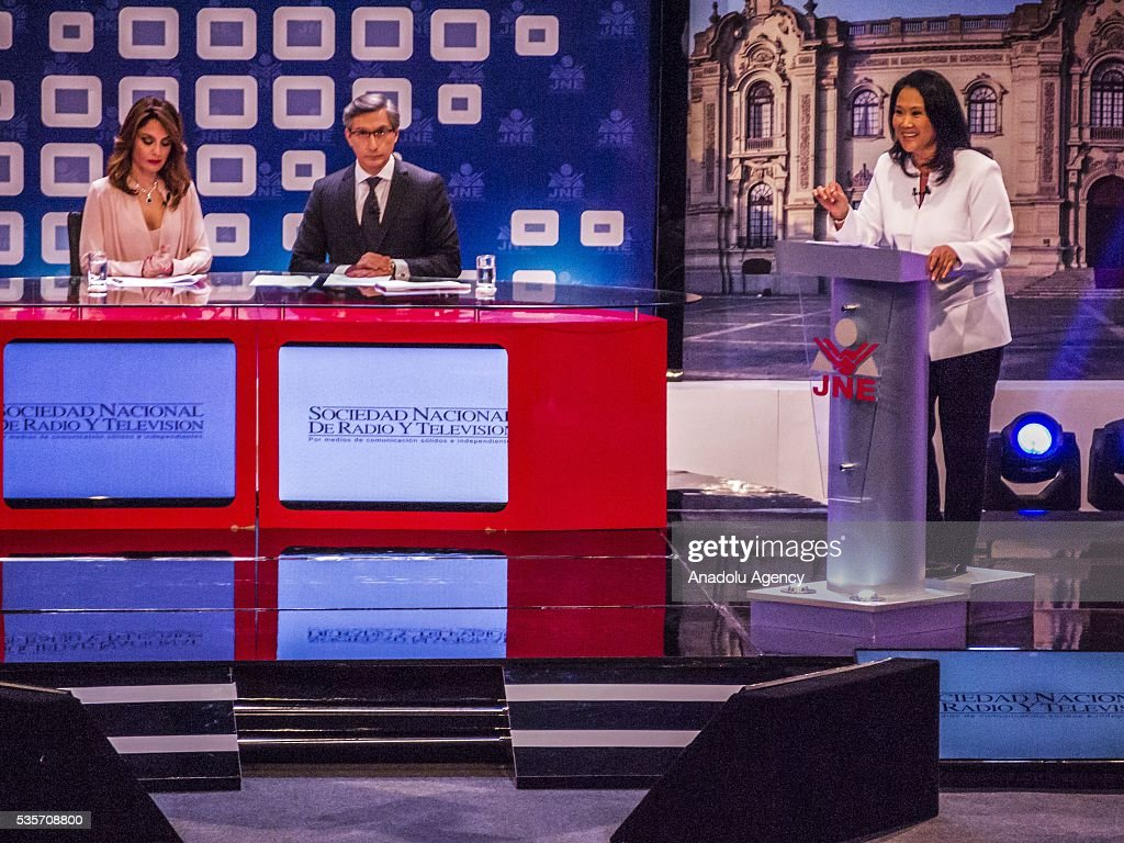 Peruvian presidential candidate for the Fuerza Popular (Popular Strength) party Keiko Fujimori (R) and presidential candidate Pedro Pablo Kuczynski of the 'Peruanos por el Kambio' (Peruvians for change) party (not seen) attend a presidential debate in Lima on May 29, 2016.