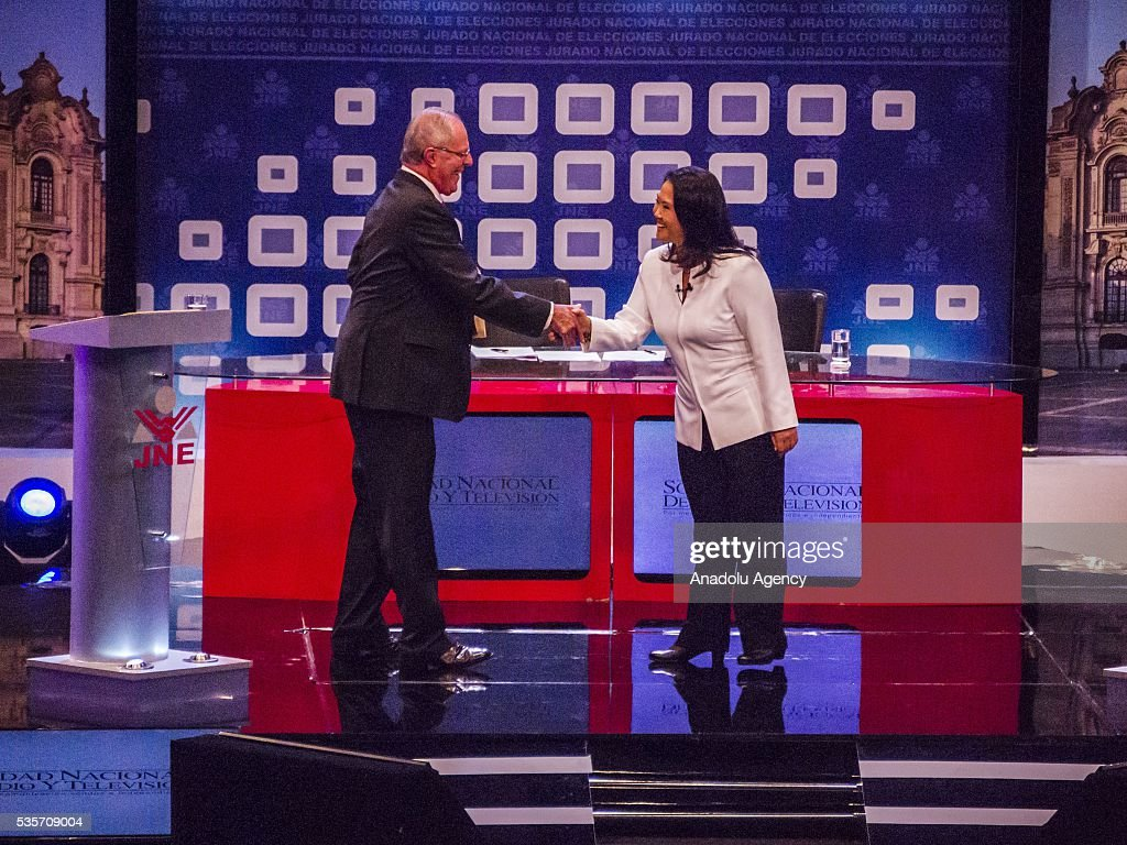 Peruvian presidential candidate for the Fuerza Popular (Popular Strength) party Keiko Fujimori (R) and presidential candidate Pedro Pablo Kuczynski of the 'Peruanos por el Kambio' (Peruvians for change) party (L) attend a presidential debate in Lima on May 29, 2016.