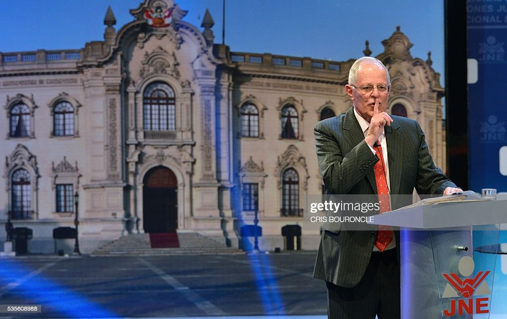 Peruvian presidential candidate Pedro Pablo Kuczynski of the 'Peruanos por el Kambio' (Peruvians for change) party gestures during a televised debate with Peruvian presidential candidate for the Fuerza Popular (Popular Strength) party Keiko Fujimori (out of frame) in Lima on May 29, 2016. Fujimori and Kuczynski will compete in Peru's June 5 runoff election. / AFP / CRIS