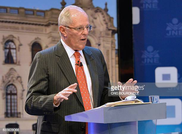 Peruvian presidential candidate Pedro Pablo Kuczynski of the 'Peruanos por el Kambio' party gestures during a televised debate with Peruvian...