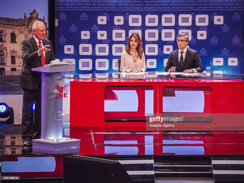 Peruvian presidential candidate Pedro Pablo Kuczynski of the 'Peruanos por el Kambio' (Peruvians for change) party (L) and presidential candidate for the Fuerza Popular (Popular Strength) party Keiko Fujimori (not seen) attend a presidential debate in Lima on May 29, 2016.