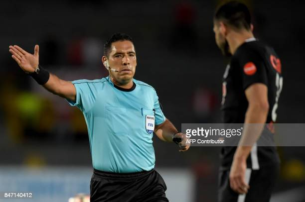Peruvian referee Diego Haro gestures during the Colombia's Santa Fe against Paraguay's Libertad Copa Sudamericana football match at El Campin stadium...