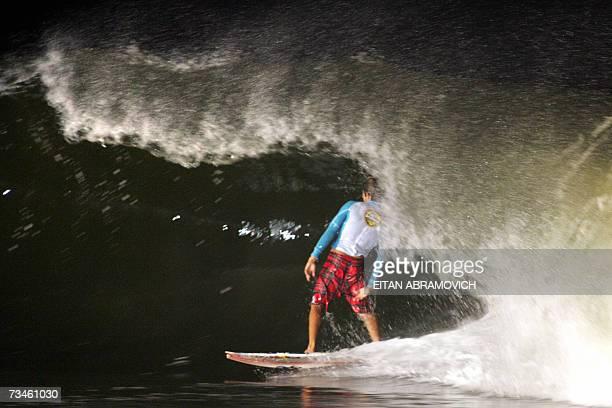 Peruvian surfer Gabriel Villaran Pan American champion 2006 rides the tube of a wave at Punta Rocas beach 45 km south from Lima 16 February 2007...