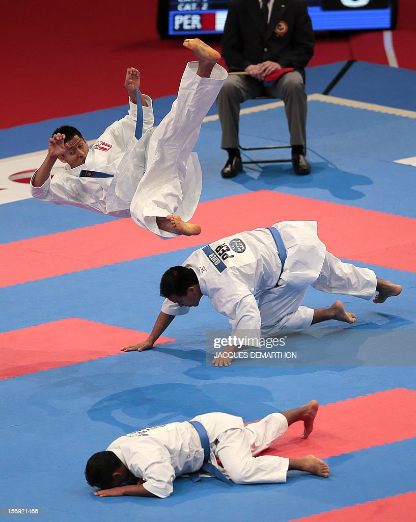 Peruvian team members compete against Egypt on November 25, 2012 during the men's team kata semi-finals of the Karate world championships at the POPB stadium in Paris. DEMARTHON