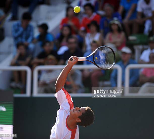 Peruvian tennis player Pablo Varillas serves during his Copa Davis match against Chilean Nicolas Jarry in Santiago on March 6 2015 AFP PHOTO/Vladimir...
