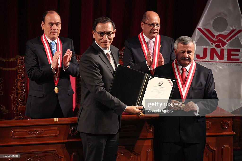 Peruvian Vice-President Martin Vizcarra (L) receives his credentials from the president of the National Electoral Jury (JNE), Francisco Tavara, during a ceremony in Lima on June 28, 2016 a month before taking office.