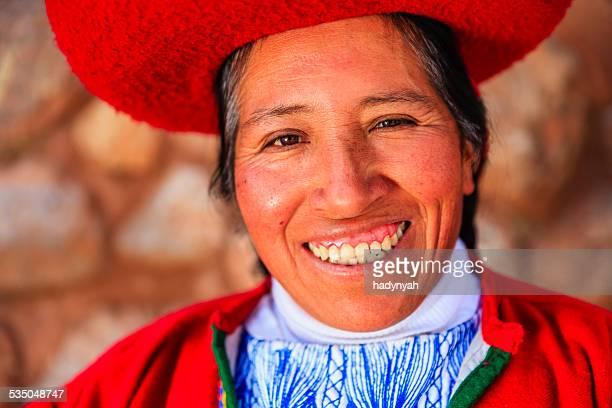 Peruvian woman at Inca ruins, The Sacred Valley, Peru