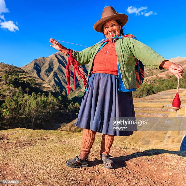 Peruvian woman spinning wool by hand, Sacred Valley, Peru