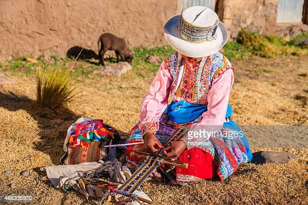 Peruvian woman weaving near Colca Canyon, Peru
