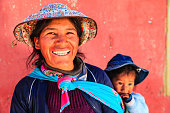 Peruvian woman with her baby on the back near Arequipa