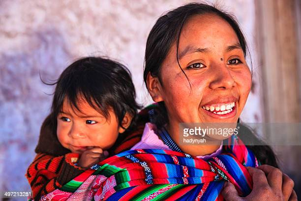 Peruvian woman with her baby on the back, Pisac