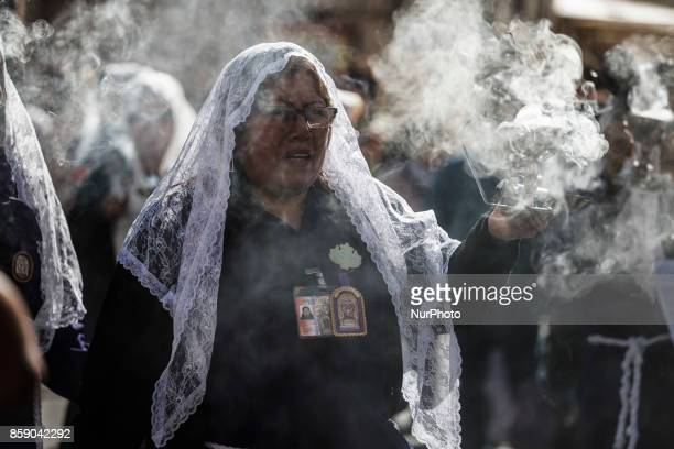 Peruvian women known as quotSahumadorasquot burn incense while participating in a procession honoring Peru's most revered Catholic religious icon the...