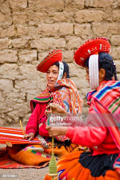 Peruvian women spinning yarn