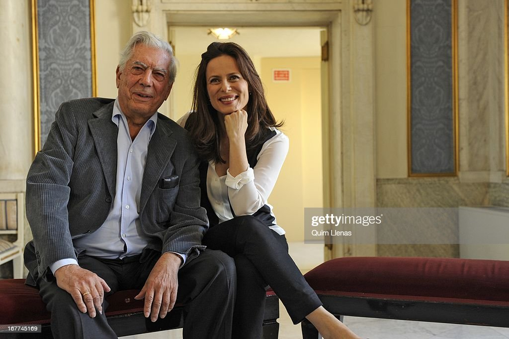 Peruvian writer Mario Vargas Llosa and actress Aitana Sanchez Gijon pose for a photo shoot after the press conference for 'La Chunga' play at Espanol Theatre on April 24, 2013 in Madrid, Spain.