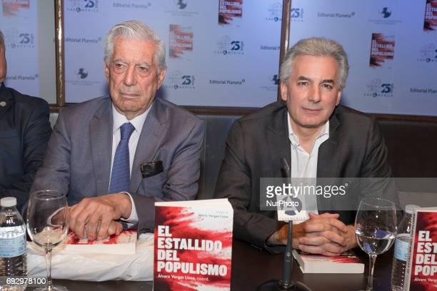 Peruvian writer Mario Vargas Llosa and his son Alvaro Vargas Llosa pose during the presentation of the collective work 'El estallido del populismo'...