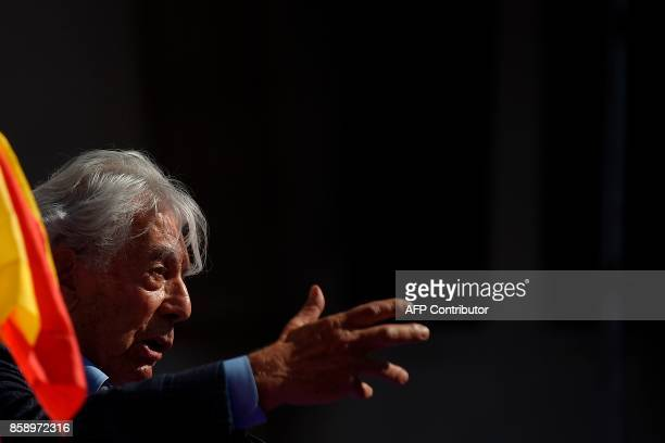 Peruvian writer Mario Vargas Llosa gives a speech during a demonstration called by 'Societat Civil Catalana' to support the unity of Spain on October...