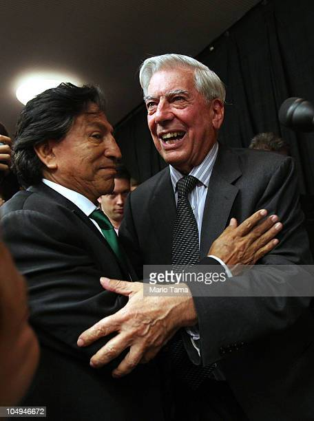 Peruvian writer Mario Vargas Llosa is hugged by former Peruvian President Alejandro Toledo at a press conference at Instituto Cervantes after Llosa...