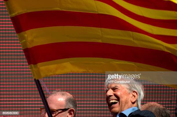 Peruvian writer Mario Vargas Llosa waves a Catalan flag during a demonstration called by 'Societat Civil Catalana' to support the unity of Spain on...
