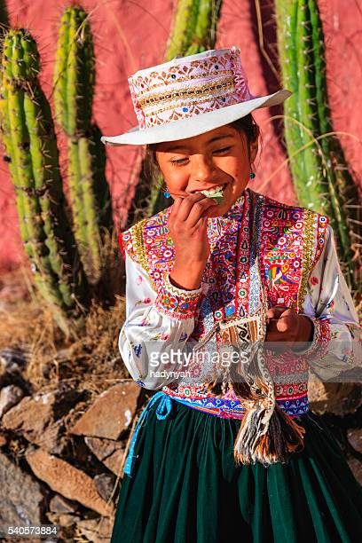 Peruvian young girl chewing coca leaves, Chivay, Peru
