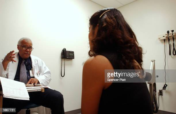 PeruvianAmerican woman who has tuberculosis speaks with her doctor at the TB clinic at the University of Medicine and Dentistry of New Jersey...