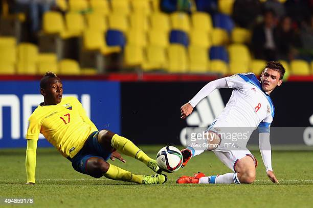 Pervis Estupinan of Ecuador is challenged by Georgy Makhatadze of Russia during the FIFA U17 World Cup Chile 2015 Round of 16 match between Russia...