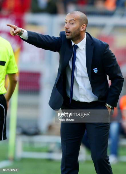 Pescara head coach Cristian Bucchi gestures during the Serie A match between AS Roma and Pescara at Stadio Olimpico on April 21 2013 in Rome Italy