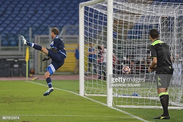 Pescara's Argentinian goalkeeper Albano Benjamin Bizzarri takes a goal from Lazio's defender from Romania Stefan Radu during the Italian Serie A...