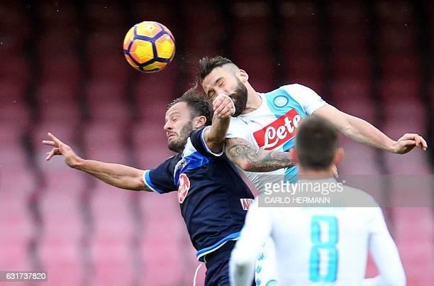 Pescara's Italian forward Alberto Gilardino head the ball as he fights for it with Napoli's Italian defender Lorenzo Tonelli during the Italian Serie...