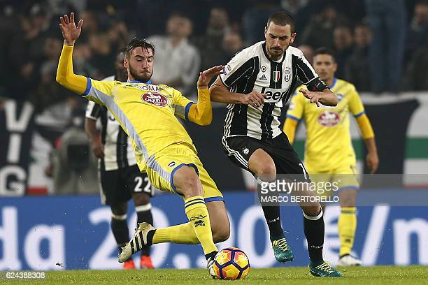 Pescara's midfielder Bryan Cristante fights for the ball with Juventus' defender Leonardo Bonucci during the Italian Serie A football match Juventus...