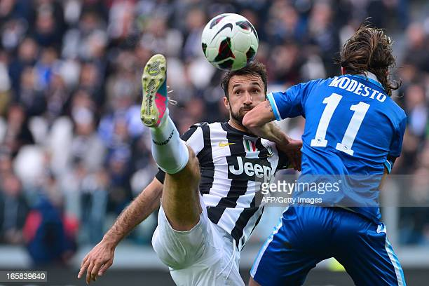 Pescara's midfielder Franceso Modesto fights for the ball with Juventus' forward of Montenegro Mirko Vucinic during their Serie A football match...