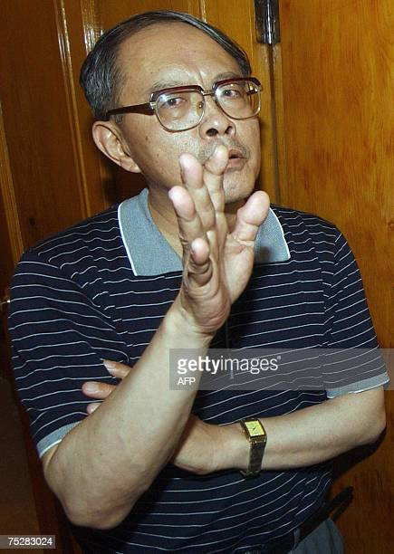 China's deputy ambassador in Pakistan Mao Siwei gestures as he speaks with media representatives in Peshawar 09 July 2007 after unidentified gunmen...