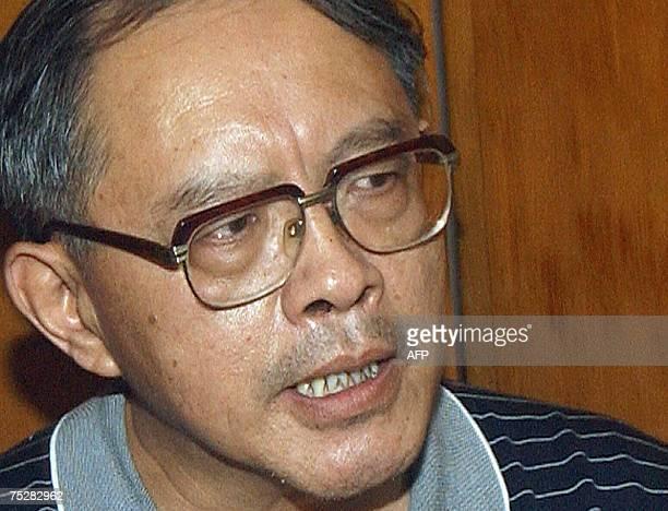 China's deputy ambassador to Pakistan Mao Siwei talks with media representatives in Peshawar 09 July 2007 after unidentified gunmen killed three...